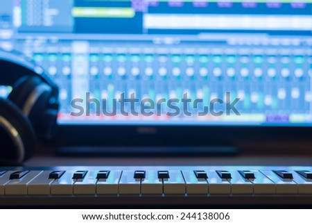 Music production at night. With keyboard and headphones. - stock photo