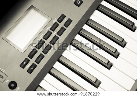 Music Synthesizer closeup. keyboard and controls.
