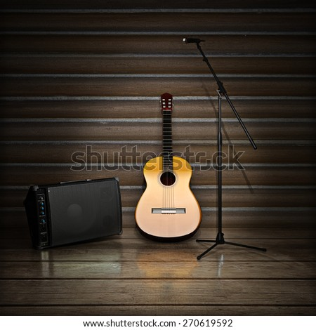 Music themed background with acoustic guitar , amp and microphone.  - stock photo