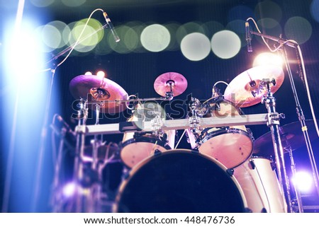 Musical background.Drum kit on stage lights performance.Live music.Concert and band on stage.Festival and show background - stock photo