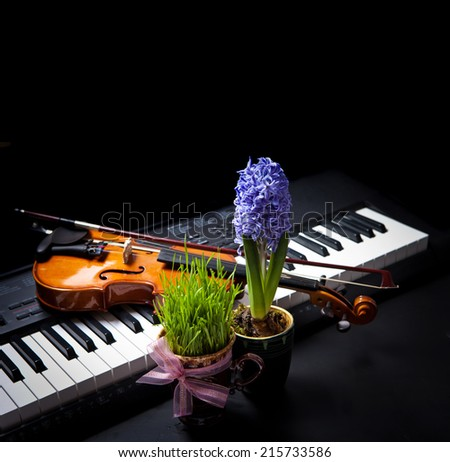 Musical background with spring flowers - stock photo