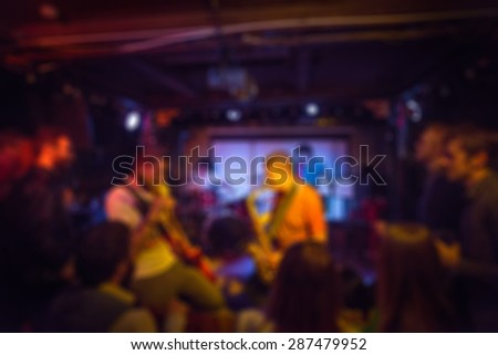 Musical band performing live blur background with abstract bokeh - stock photo