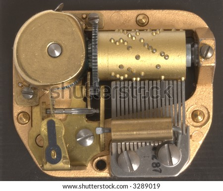 Musical box inside mechanism close up - stock photo