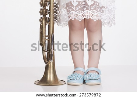 musical child.little girl with trumpet.musical instrument - stock photo