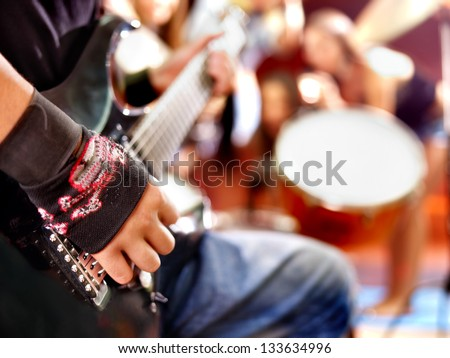 Musical group playing in night club. Body part. - stock photo