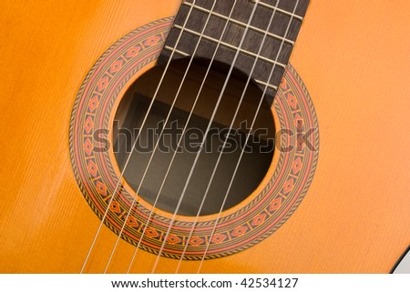 Musical instrument acoustic guitar body close up - stock photo