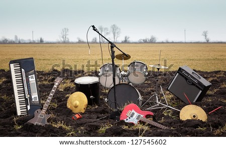 Musical instruments on the dirty spring field - stock photo