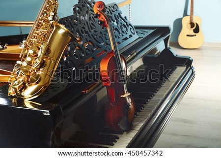 Musical instruments with piano, close up - stock photo