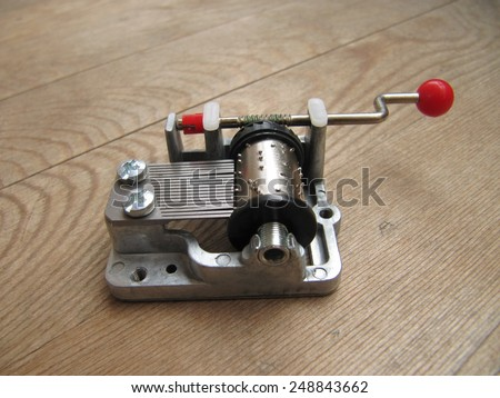 Musical machine in wooden table, sounds like a melody. - stock photo