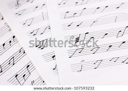 Musical notes and feather close-up - stock photo
