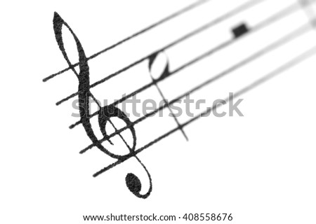 Musical notes and treble clef. - stock photo