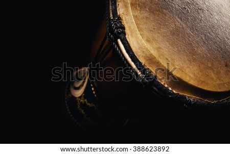 Musical percussion instrument details, closeup view of a djembe.