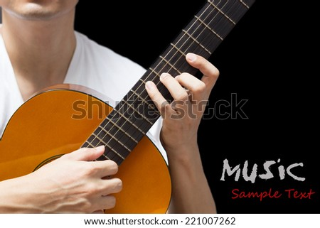 musician , guitarist plays classical / acoustic guitar, isolated on black - stock photo