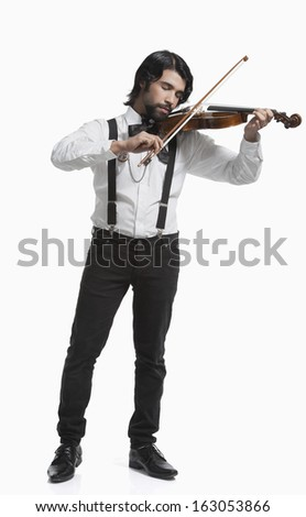 Musician playing a violin - stock photo