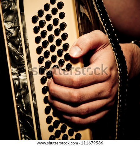 musician playing accordion in studio - stock photo