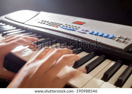Musician playing on keyboards - stock photo