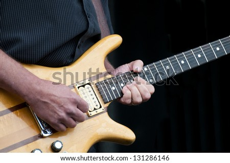 Musician playing the electric guitar at a local festival