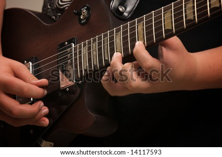 Musician Plays His Gibson Les Paul Studio Electric Guitar - stock photo
