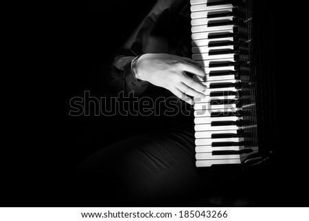 musician plays the accordion. Musician make glissando or claster - stock photo