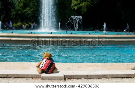 Musician teddy bear plays accordions - stock photo