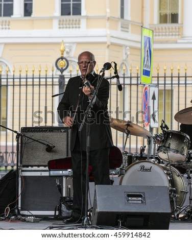 Musician with a violin. St. Petersburg, Russia - 23 July, 2016. Speech by David Goloschekin with his jazz group on the Arts Square in St. Petersburg.
