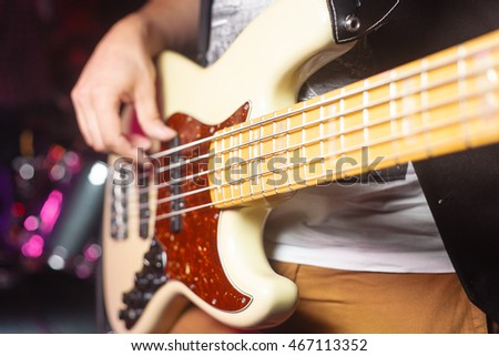musician with guitar playing a song