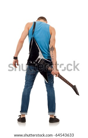 Musician with his guitar on his back over white - stock photo
