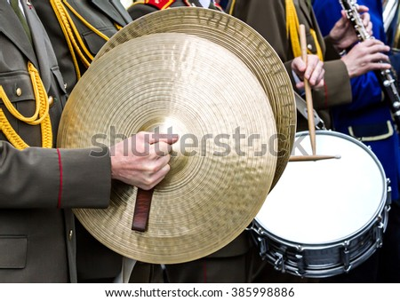 musicians of military brass band plays the musical instruments at parade - stock photo