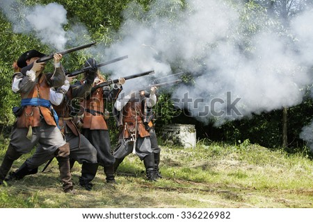 Musketeers in period dress firing rifles. 9th July 2011, CESKY RUDOLEC. CZECH REPUBLIC - stock photo