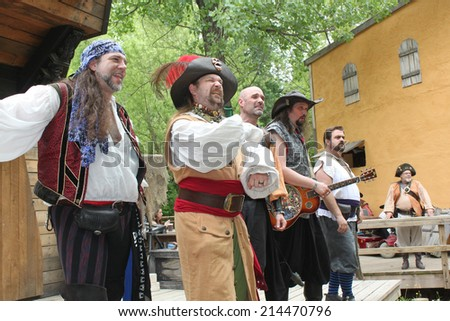 MUSKOGEE, OK - MAY 24: Men dressed as pirates sing at the Oklahoma 19th annual Renaissance Festival on May 24, 2014 at the Castle of Muskogee in Muskogee, OK.