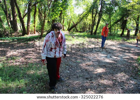 MUSKOGEE, OK - Sept. 12: An actor dressed as zombie waits for the next runner during the Castle Zombie Run at the Castle of Muskogee in Muskogee, OK on September 12, 2015.  - stock photo