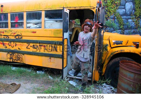MUSKOGEE, OK - Sept. 12: Bloody zombies hide in school bus during the Castle Zombie Run at the Castle of Muskogee in Muskogee, OK on September 12, 2015.   - stock photo