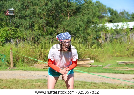 MUSKOGEE, OK - Sept. 12: Runners overcome obstacles during during the Castle Zombie Run at the Castle of Muskogee in Muskogee, OK on September 12, 2015.   - stock photo