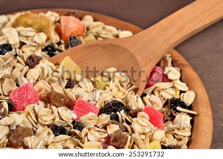 Musli in a wooden spoon - stock photo