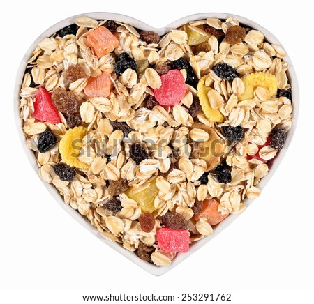 Musli  in plate in the form of heart in a white background - stock photo