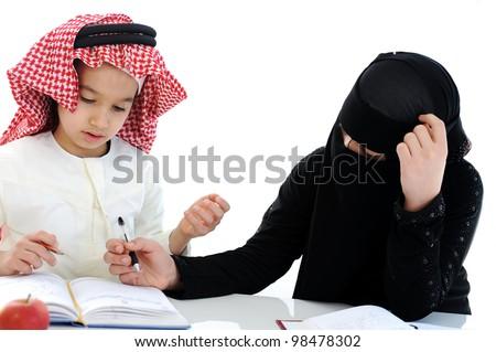 Muslim Arabic boy and girl at school - stock photo