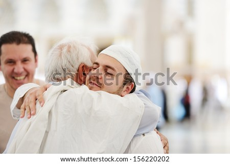 Muslim Arabic brothers meeting together with father - stock photo