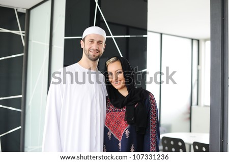Muslim Arabic couple together indoors - stock photo