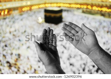 Muslim Arabic man praying at Kaaba in Mecca - stock photo