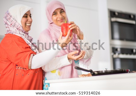 Muslim Arabic traditional woman in kitchen preparing food for lunch