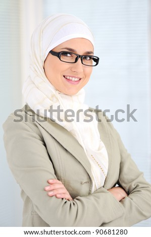 Muslim business woman in office - stock photo