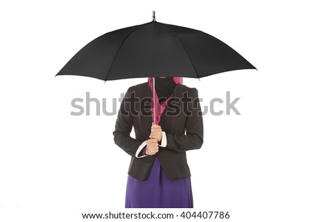 Muslim Business woman is holding black umbrella.