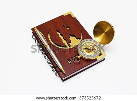 Muslim compass with Notepad and pen.