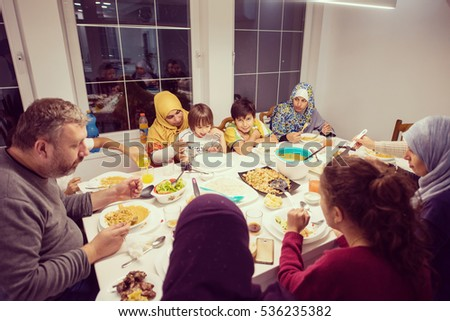 Muslim family eating meal