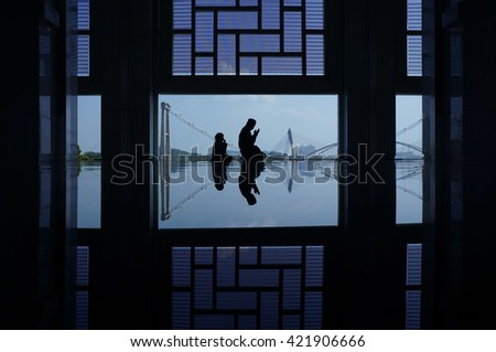 Muslim father and his daughter praying inside the mosque                                - stock photo