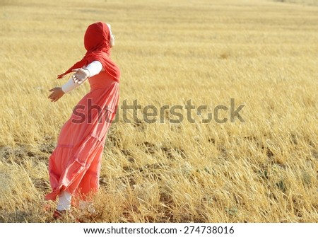 Muslim girl enjoying in nature - stock photo