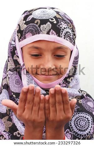 Muslim girl praying - stock photo