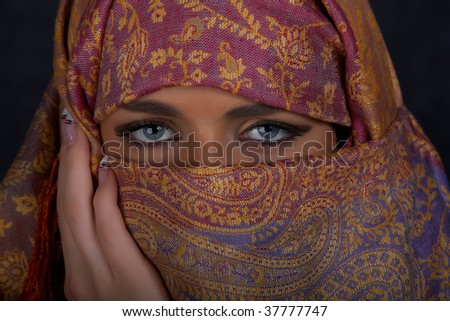Muslim girl with beautiful blue eyes