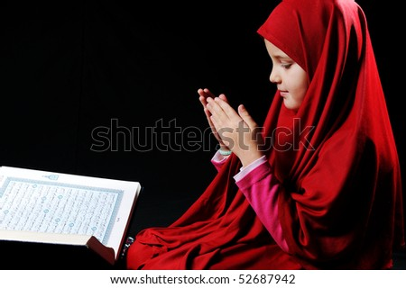 Muslim girl with Holy Book Koran - stock photo