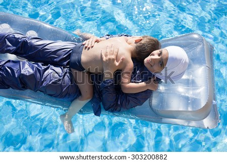 Muslim girl with special swimming suit - stock photo
